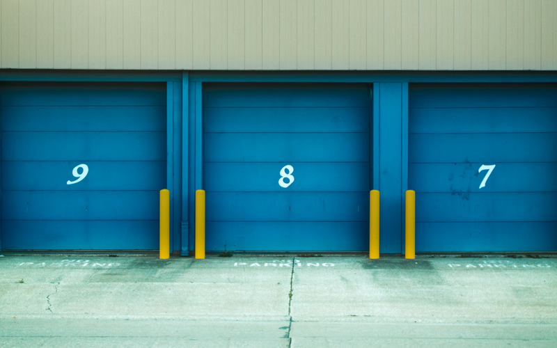 A storage facility is shown with numbered doors.