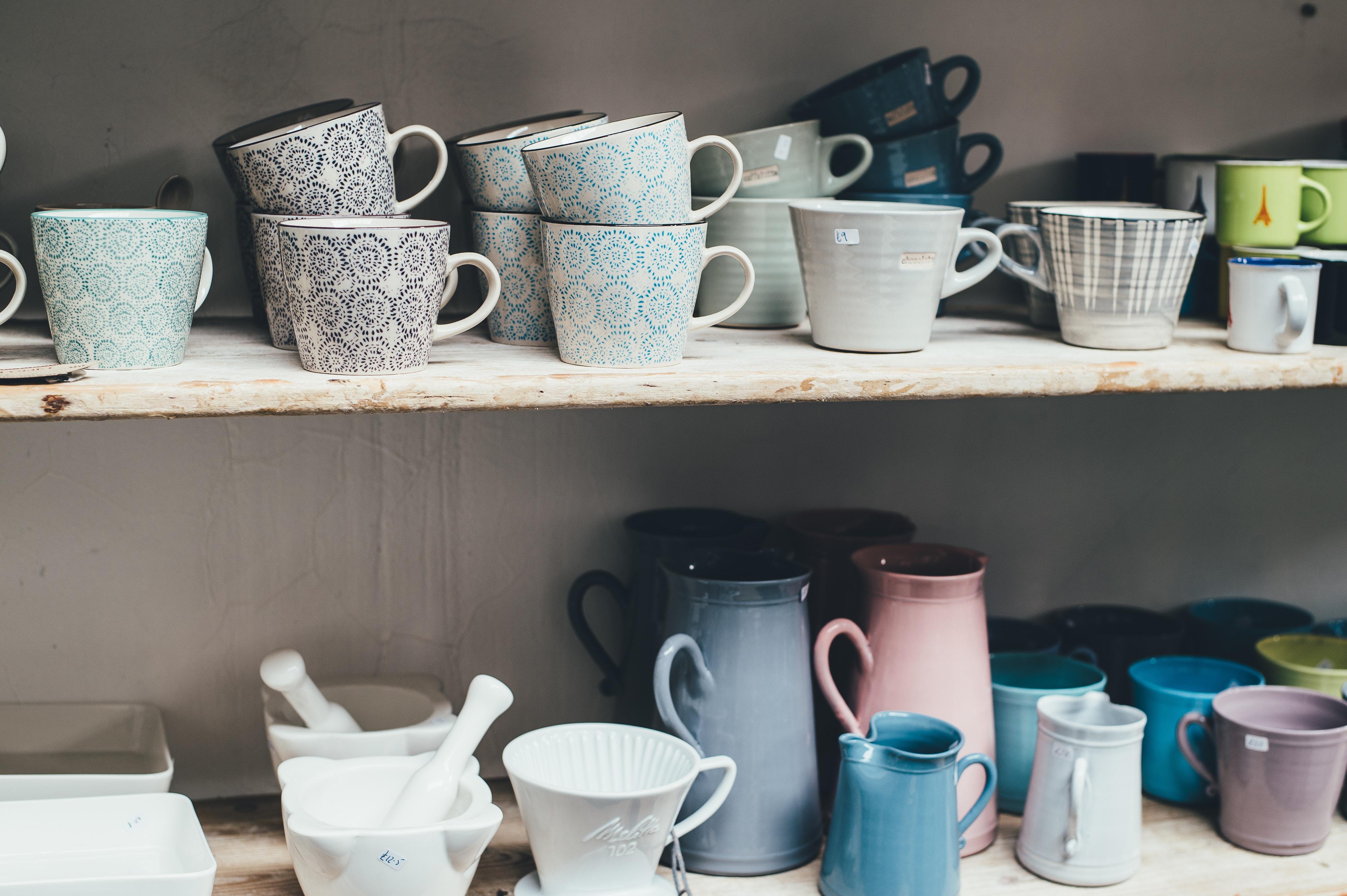 two shelves full of mugs