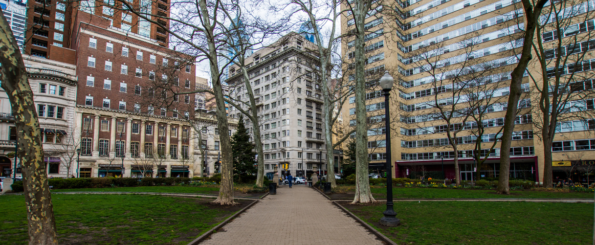Rittenhouse Square park in the spring with city buildings surrounding it
