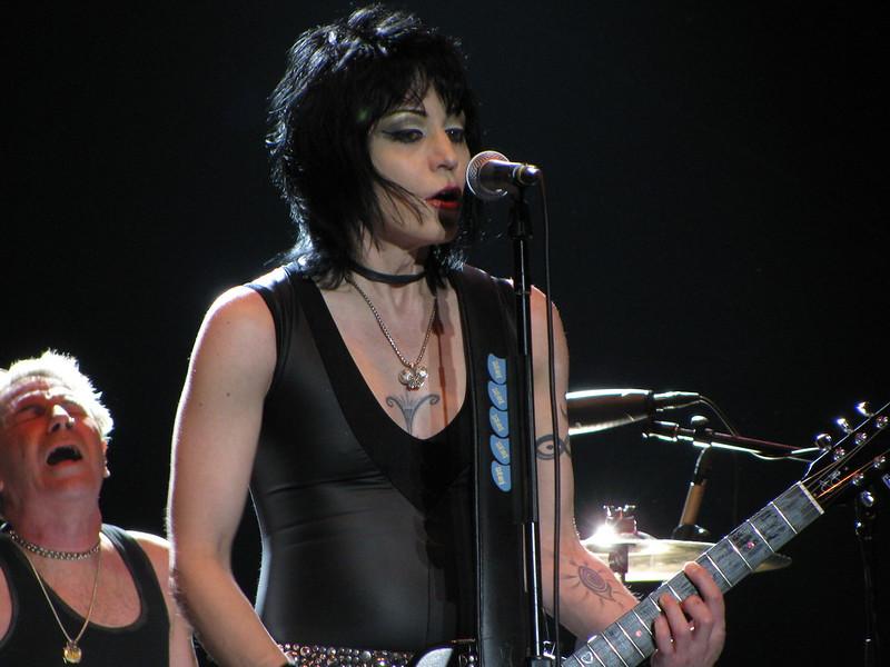 rocker with black hair singing